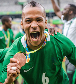 Nigeria's William Ekong displays his bronze medal during the medal ceremony after defeating Honduras in the Rio 2016 Olympic Games men's bronze medal football match at the Mineirao stadium in Belo Horizonte, Brazil, on August 20, 2016.  / AFP PHOTO / GUSTAVO ANDRADE