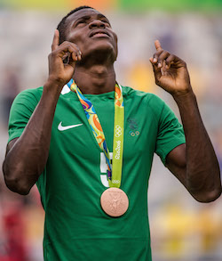 Nigeria's Saturday Erimuya reacts after receiving the bronze medal during the medal ceremony after defeating Honduras in the Rio 2016 Olympic Games men's bronze medal football match at the Mineirao stadium in Belo Horizonte, Brazil, on August 20, 2016. / AFP PHOTO / GUSTAVO ANDRADE