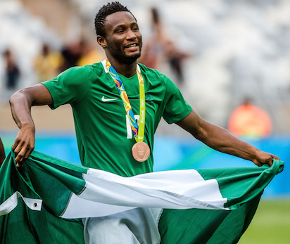 Nigeria's John Obi Mikel celebrates after receiving the bronze medal during the medal ceremony after defeating Honduras in the Rio 2016 Olympic Games men's bronze medal football match at the Mineirao stadium in Belo Horizonte, Brazil, on August 20, 2016.  / AFP PHOTO / GUSTAVO ANDRADE