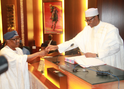 President Muhammadu Buhari congratulating the Permanent Secretary Foreign Affairs, Amb. Abdulrafiu Enikanolaiye after taking the oath of office as  a Federal Permanent Secretary at the Aso Chambers, State House, Abuja.