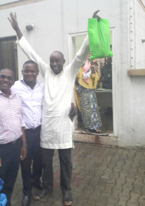 Blogger Abubakar Sidiq Usman (right) freed by the EFCC on Tuesday, August 9, 2016.