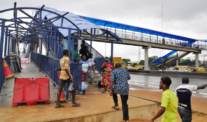 Pedestrian Bridge at Berger bus stop being used by the people shortly after completion along Lagos-Ibadan Expressway by the Lagos State Government, on Wednesday, August 10, 2016.