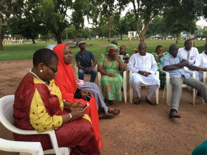 ‎Oby Ezekwesili with parents of parents of Dorcas Yakubu (mother in green, father in white), the girl who addressed concerned parents in the video released by Boko Haram