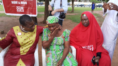 ‎Oby Ezekwesili with parents of Dorcas Yakubu (mother in green), the girl who addressed concerned parents in the video released by Boko Haram