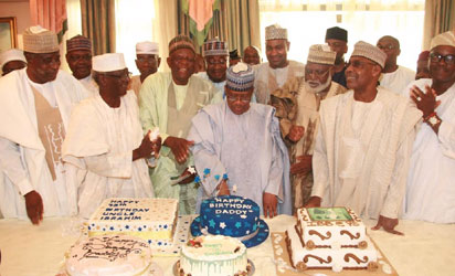 Former Head of State, Gen. Ibrahim Babangida cuts his cake while his guests applauded during prayers to mark the 75th Birthday celebrations for Gen. Babangida at the Hilltop, Minna, Niger State
