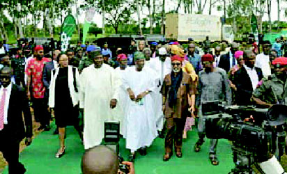 •Enugu Governor, Ifeanyi Ugwuanyi, leading Labour Minister, Chris Ngige, Informtion Minister, Lai Mohammed and others to the venue of the Town Hall meeting.