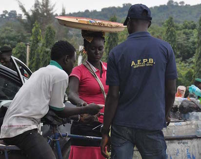 Bribe in the Open: Officers of the Abuja Environmental Protection Board (AEPB) Enforcement Squad collecting bribe at Villa gate yesterday. Photo by Gbemiga Olamikan .