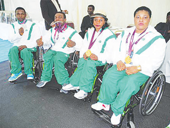 READY TO GO . . . Nigeria's Paralympic athletes show off their medals after the London Games reception. They look set to win more medals in Rio 2016.