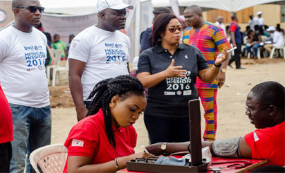MEDICAL MISSION:The Sole Administrator, Alimosho LCDA, Hon. Ganiu Quadri being conducted round the various centres by the Managing Director of PathCare  Laboratories, Dr. Pamela Ajayi during the 2016 Doctors On Air Medical Mission held weekend in Alimosho LCDA,  Lagos.