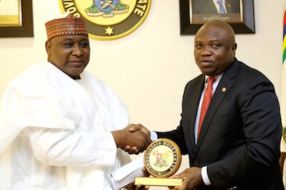 agos State Governor, Mr. Akinwunmi Ambode (right), presenting a State plaque to Chairman, Indices & Disbursement Committee, Federal Revenue Mobilisation Allocation and Fiscal Commission, Alhaji Aliyu Mohammed during the Committee's courtesy call to the Governor at the Lagos House, Ikeja