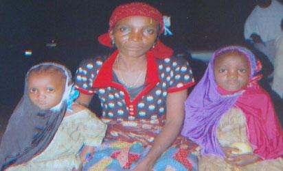 •Asmau (middle) and the rescued girls, Amina and Rukayya