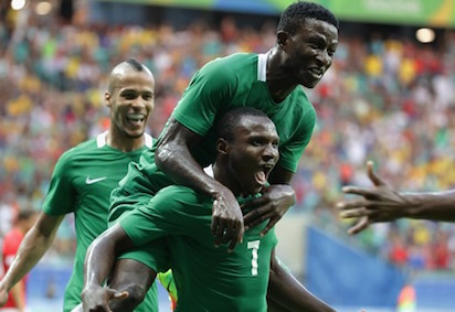 Aminu Umar of Nigeria celebrates with team mates after scoring a goal during the Men's Football Quarter Final match between Nigeria and Denmark on Day 8 of the Rio 2016 Olympic Games at Arena Fonte Nova on August 13, 2016 in Salvador, Brazil. (Photo  - FIFA/FIFA
