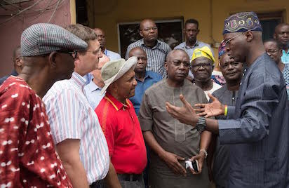 Hon Minister of Power, Works & Housing, Mr Babatunde Fashola, SAN (right) discussing with  Lagos State Commissioner for Transportation, Dr Dayo Mobereola (4th right), Federal Controller of Works, Engr. Godwin Eke (middle), South West Public Relations Officer of the Petroleum Tanker Drivers (PTD) Branch of the Nigeria Union of Petroleum and Natural Gas Workers (NUPENG), Comrade Tayo Aboyeji (2nd right), President Association of Maritime Truck Owners (AMATO) ,Chief Remi Ogungbemi (3rd right) and officials of Julius Berger Nigeria Plc immediately after the Minister's meeting with stakeholders to  solicit cooperation on the immediate closure of the  Apapa-Ijora Bridge linking the Apapa Central Business District with Lagos Island in Lagos by the Federal Government for emergency repair works on Sunday 7th August , 2016.