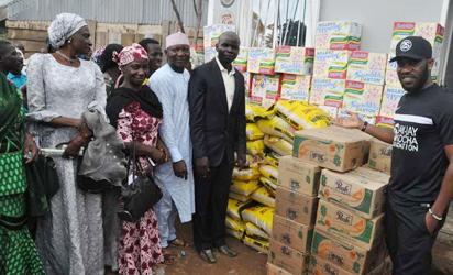 Okocha @43: Austin JJ Okocha of Former Super Eagle donating foods items to celebrate his 43th birthday during his visit to children of Internally Display People (IDP) Camp at Kuchigoro Abuja Sunday. Photo by Gbemiga Olamikan