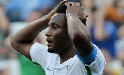 Nigeria's John Obi Mikel reacts during the Rio 2016 Olympic Games men's football semifinal match against Germany at the Corinthains Arena in Sao Paulo, Brazil, on August 17, 2016. / AFP PHOTO