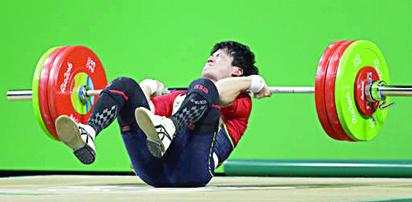 Yosuke Nakayama, of Japan, falls during the men's 62kg weightlifting competition in Rio.