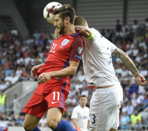 Slovakia's defender Martin Skrtel (R) and England's forward Adam Lallana vie for the ball during the World Cup 2018 football qualification match between Slovakia and England in Trnava on September 4, 2016.  / AFP PHOTO / JOE KLAMAR