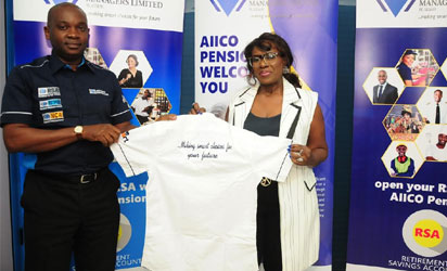 Managing Director, AIICO Pension Managers Limited. Mr Eguarekhide Longe presenting a souvenir to Joke Silva