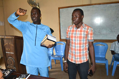 "Managing/Online Editor, Nation Newspapers, Mr Lekan Otufodunrin presenting the book ""JOURNALISM OF MY LIFE"" to the President, Journalism Students'Association, Lagos State University, Muhammad Oluwatosin Bolaji"