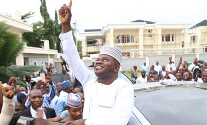 : Kogi State Governor Yahaya Bello waving his supporters shortly after the ruling of the supreme court in his favour in Abuja yesterday. Photo by Gbemiga Olamikan