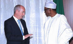 R-L: President Muhammadu Buhari and Shell Director, Mr. Andrew Brown