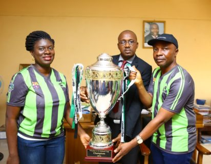 L-R: Manager, Sponsorship, Etisalat Nigeria, Orah Egwu; Permanent Secretary, Ministry of Education, Enugu State, Mr. Augustine Ude and Head, Regional Sales, South East, Etisalat Nigeria, Okechukwu Nwaeze with the Champions Trophy during a courtesy visit to the ministry.