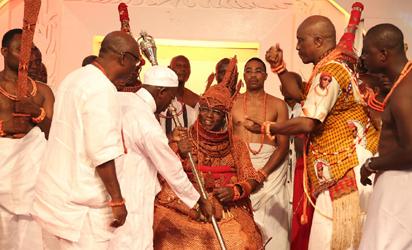 Governor Adams Oshiomhole of Edo State presents the Staff of Office to His Royal Majesty, Omo n'Oba n'Edo Uku Akpolokpolo, Oba Ewuare II, Oba of Benin after his coronation, Thursday