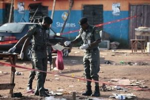 Police bomb experts at a car bomb scene
