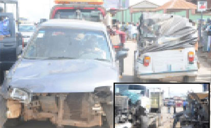 Some of the vehicles and tricycles crushed by the truck (inset) in Ibadan, yesterday. PHOTOS: Dare Fasube.