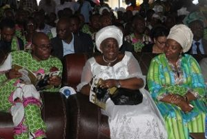 Minister of Transportation, Rt. Hon. Chibuike Rotimi Amaechi and his wife Judith (right) with wife of Late Chief GU Ake (middle) at the funeral of the deceased, on Friday.