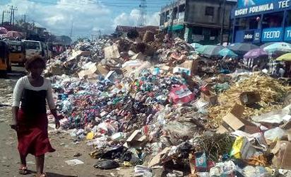 REFUSE—The refuse dump along Douglas Road, Owerri, Imo State.
