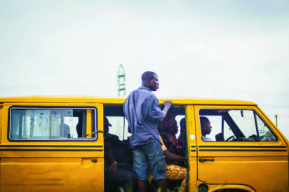 *A Lagos bus conductor on the beat.