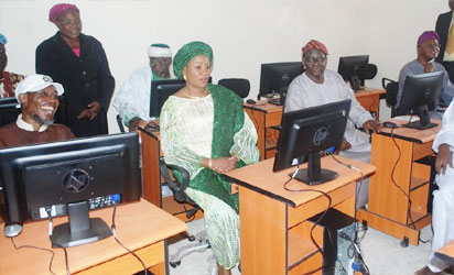 Osun state Governor, Ogbeni Rauf Aregbesola (left) testing one of the computer sets provided for students of the newly inaugurated AUD Government Elementary School, Sabo in Osogbo. With him is his wife, Sherifat (Middle); Chairman State Universal Basic Education Board (SUBEB), Prince Felix Awofisayo (2nd right); Chief of Staff to the Governor, Alhaji Gboyega Oyetola (right) and others, after inauguration of the school on Tuesday 29-11-2016