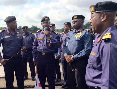 EXERCISE EAGLE EYE: Rear Admiral Adeniyi Oshinowo, Naval Chief of Training & Operations (on the mic) at the flagging off of Exercise Eagle Eye on behalf of Chief of Naval Staff, CNS, Vice Admiral Ibok-Ete Ekwe Ibas, in Warri, Delta state on Thursday. Photo by Egufe Yafugborh