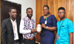 AWARD:From left, John Chukwujem Aigbogun, Attorny General SUG,UNIBEN;Mr George Paul Osondu,Operations/Business Development Manager,Oracle Experience Ltd;Miss Lauretta Oyemwenosa Obakpolo,President SUG,UNIBEN and Jatto John Ovie,Secretary General,SUG UNIBEN during the official presentation of Award of Recognition to Paul Osondu in Lagos. Photo;Akeem Salau.