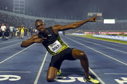 Bolt fires to win as Van Niekerk stars