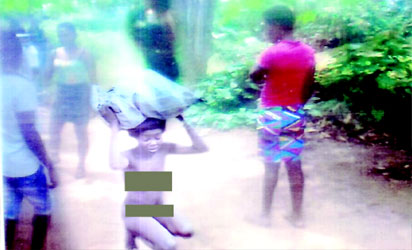 Nsini stripped by villagers and       forced to carry the allegedly stolen cassava round the village