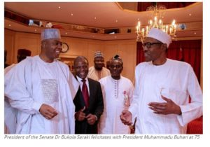 President of the Senate Dr Bukola Saraki felicitates with President Muhammadu Buhari at 75