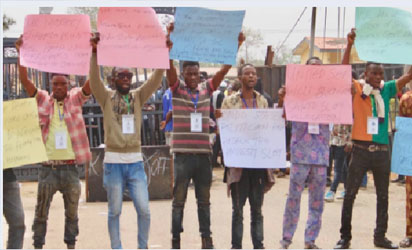 •Photograph of protesting militants blocking the entrance of OSOPADEC in OndO State