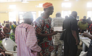 Osun pensioners receiving their cheques
