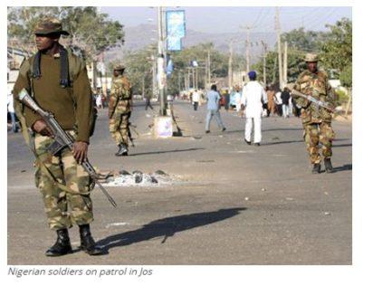Nigerian soldiers on patrol in Jos
