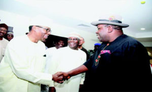 VISIT—Bayelsa State Governor, Seriake Dickson (right) exchanging pleasantries with the former Governor of Ogun State, Otunba Gbenga Daniel (left) during a visit to Government House Yenagoa, while the former Vice President, Alhaji Atiku Abubakar (centre) looks on. Photo: Lucky Francis.