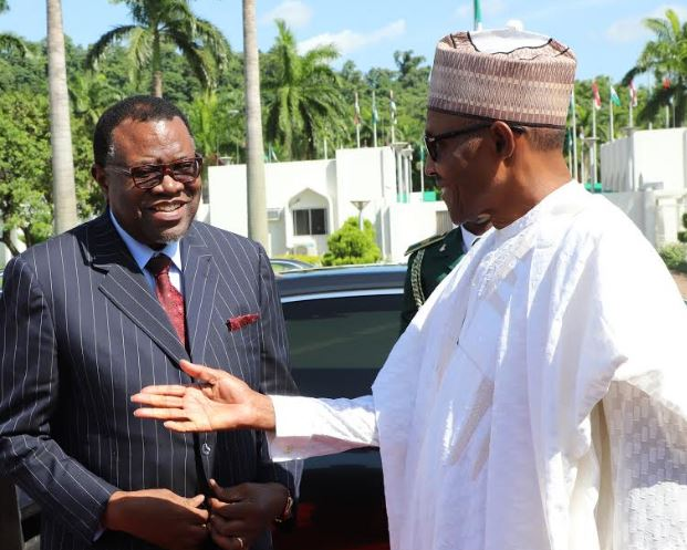 President Muhammadu Buhari (r) welcoming President Hage Geingob of Namibia as he arrived for a one-day visit at the State House, Abuja.