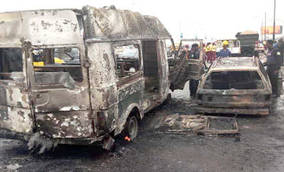 No fewer than 24 passengers, yesterday, escaped being roasted alive, when fire gutted these two vehicles on Third Mainland Bridge.