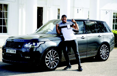 •Joshua with his car before it was stolen