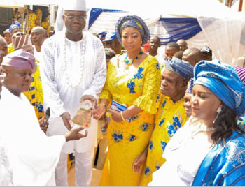 From left—Prince Rotimi Ogunleye, Lagos State Commissioner for Physical Planning & Urban Development, representing Governor Akinwunmi Ambode of Lagos State, presenting a Merit Award plaque to High Chief Owolabi Salis, Alliance for Democracy, AD, Lagos State governorship candidate; his wife, Olabisi, and other dignitaries, during the presentation of the award to Salis by Ikorodu-Oga Development Association, IKODASS, at the grand finale of Ikorodu Day celebration, in  Lagos.