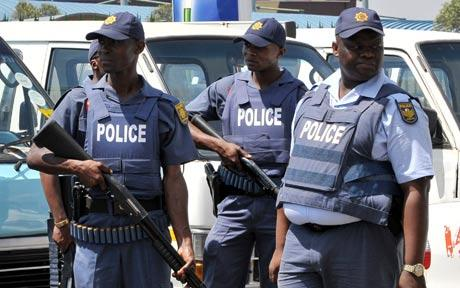 Eight South African police officers on trial over killing of Nigerian