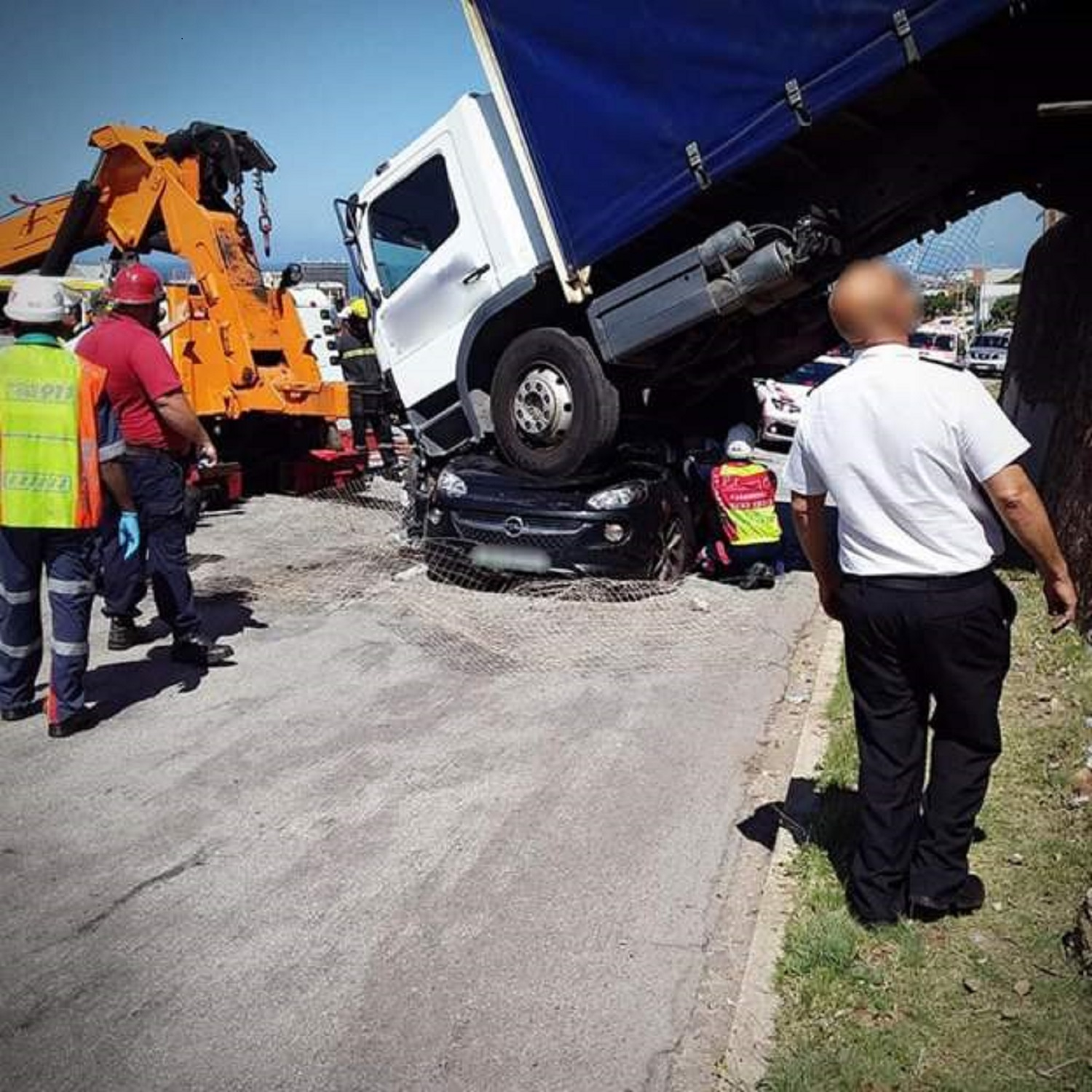 Woman survives after lorry lands on her car in South Africa