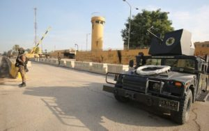 Iraq counter-terrorism forces stand guard in front of the US embassy in the capital Baghdad