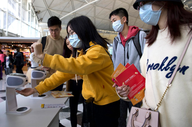 China firm develops system to recognize faces behind coronavirus masks